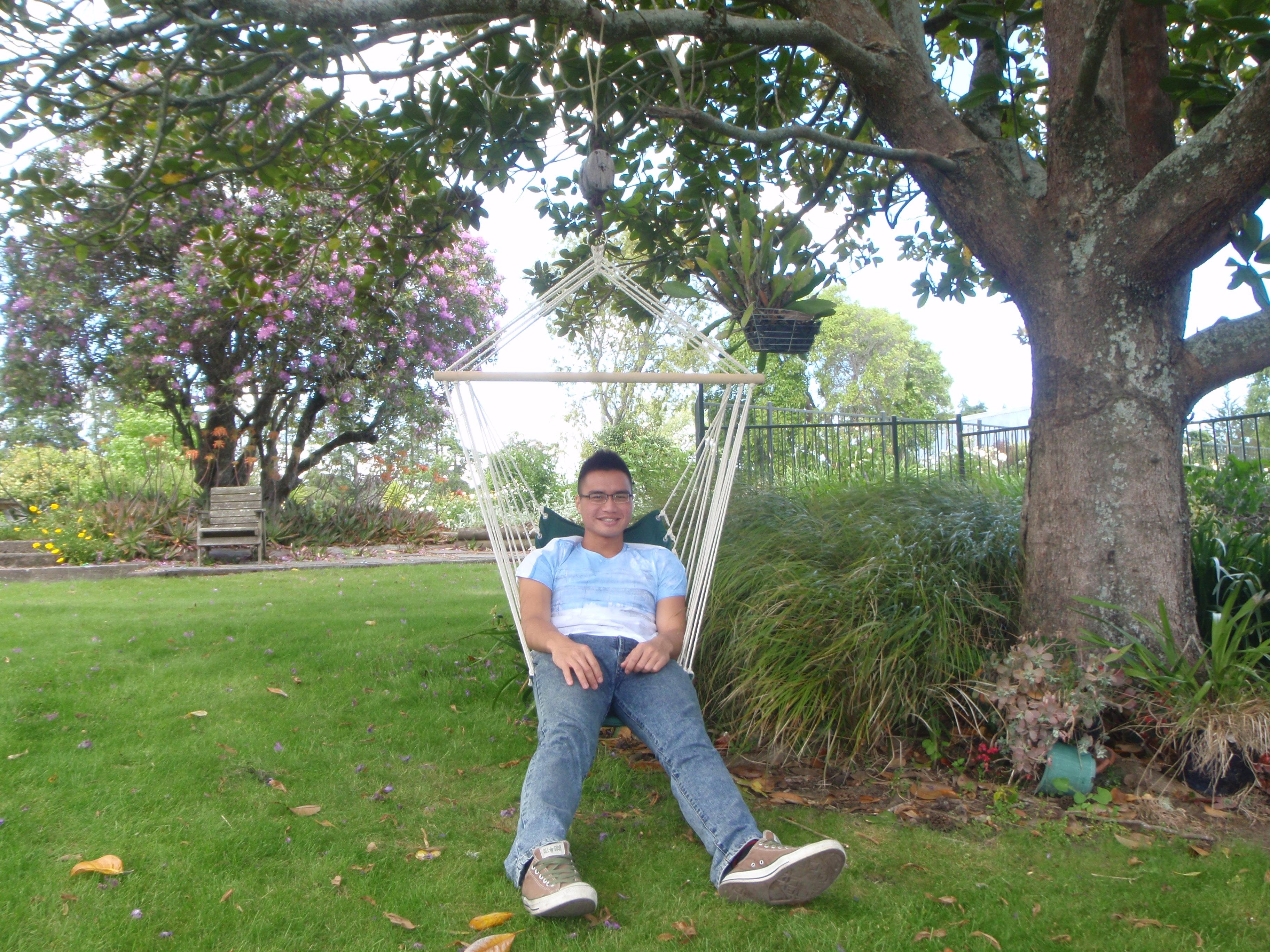 Guest enjoying the garden hanging chair