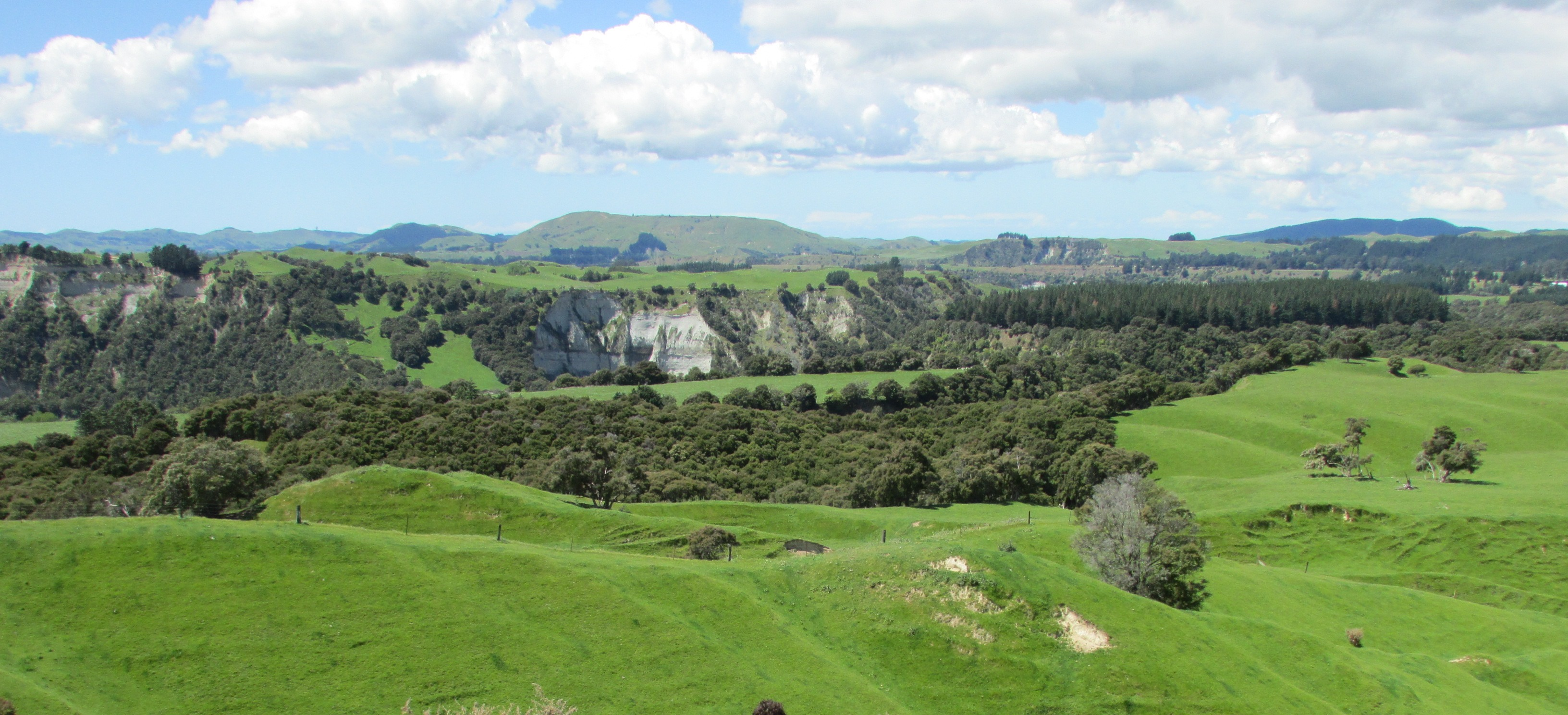River cliffs over farm land